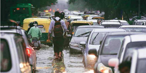 Delhi rains bring respite from heat, but disrupt smooth traffic movement