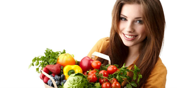 woman-holding-a-bag-full-of-healthy-food